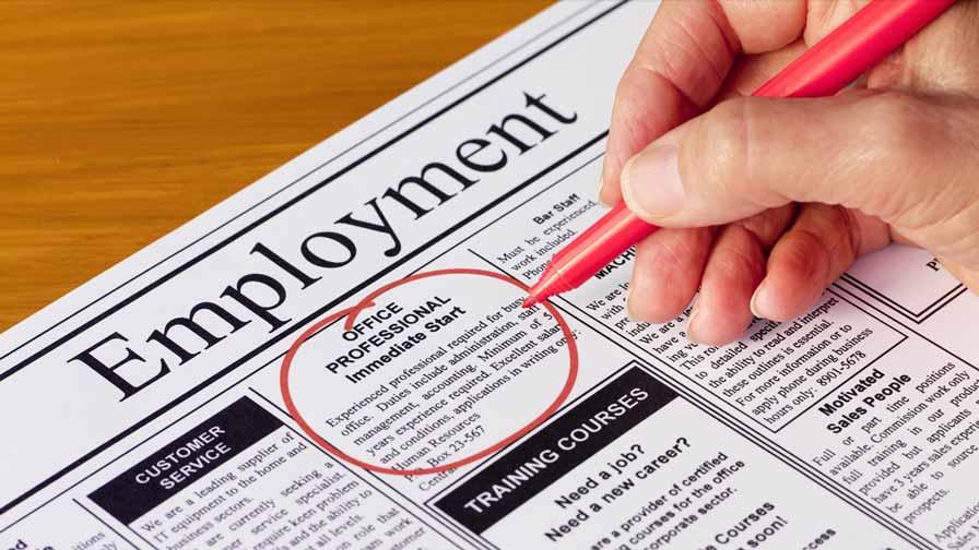 newspaper-employment-redmarker-in-hand